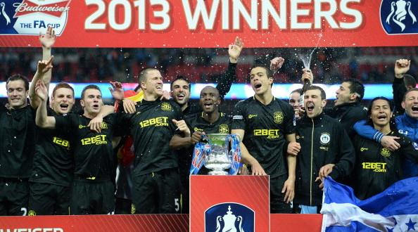 Wigan Athletic celebrate their FA Cup triumph at Wembley last year.  Photo: www.sportskeeda.com