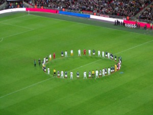 The players join for a minute of silence