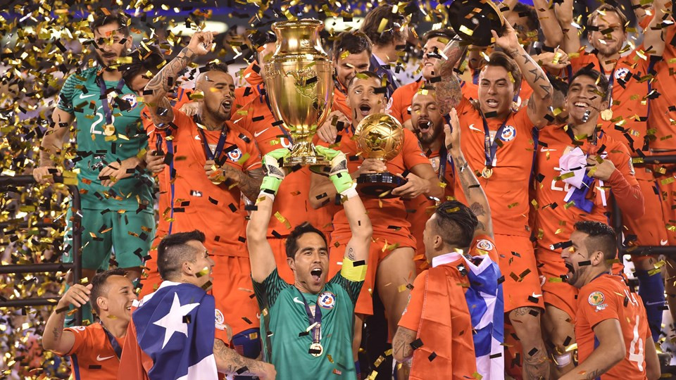 Claudio Bravo hosts the Copa America Centenario trophy. Courtesy of Fifa.com.